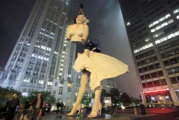 "A 26-foot tall statue of Marilyn Monroe is separated for disassembly in Chicago, May 7, 2012. The sculpture ""Forever Marilyn"" by artist Seward Johnson, is based on a scene from the movie ""Seven Year Itch"" was taken down after being on display since last July."